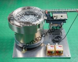чашечный вибропитатель с вибролотком для ориентации и подачи заклёпок